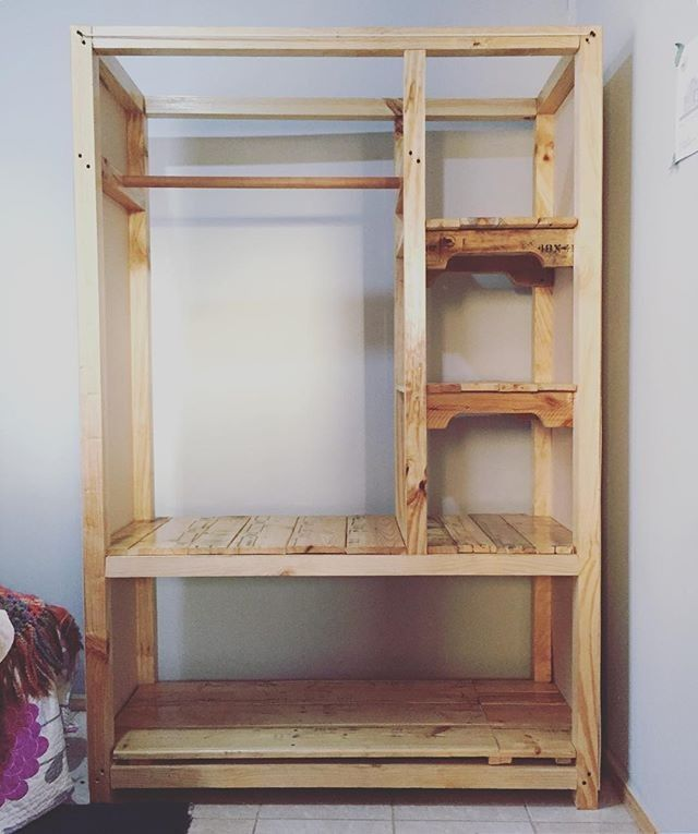 Pallet shelf with cloth hanger