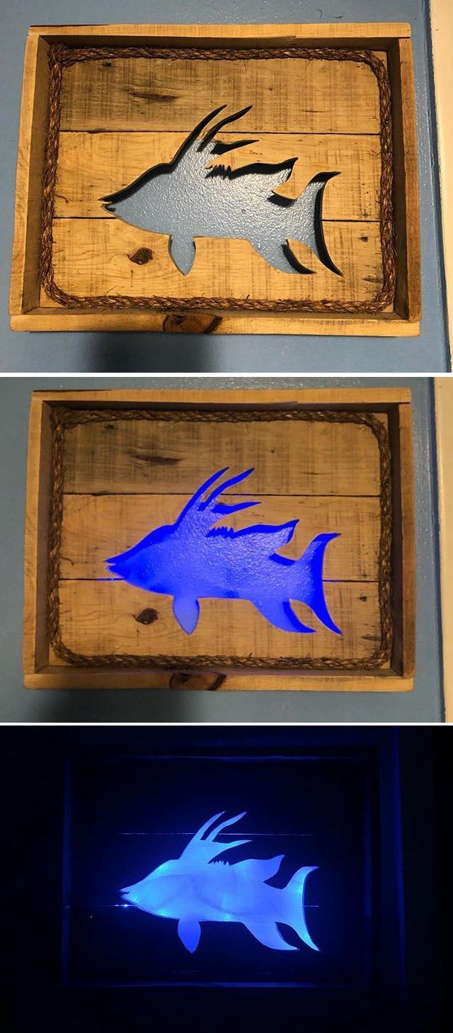 Pallet glowing fish wall art